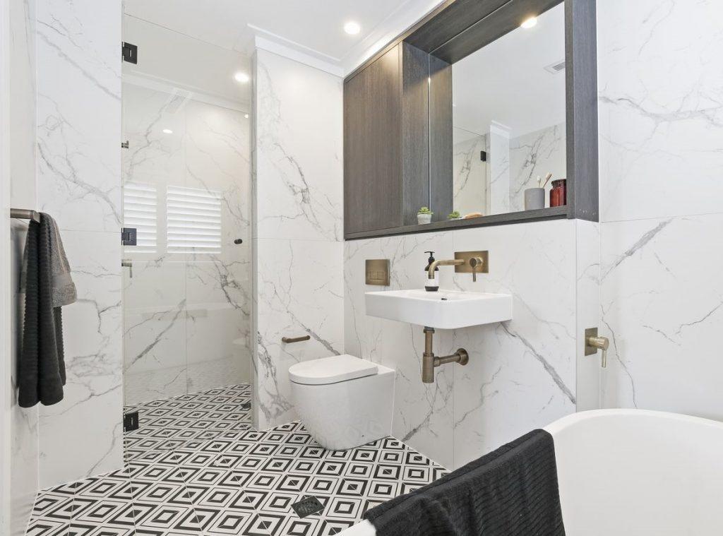 monochromatic theme bathroom with carrara porcelain wall tiles